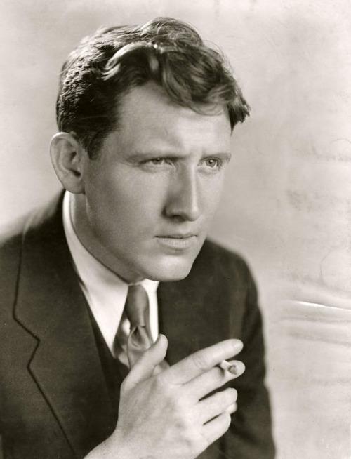 Spencer Tracy Spencer Tracy having a smoke