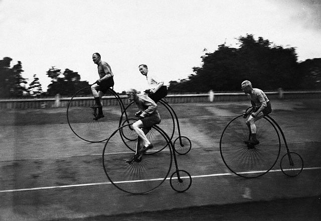 Racing along on those weird old bicycles with the huge ...