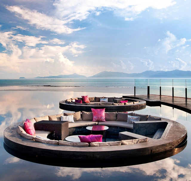 Floating conversation pits in an infinity pool
