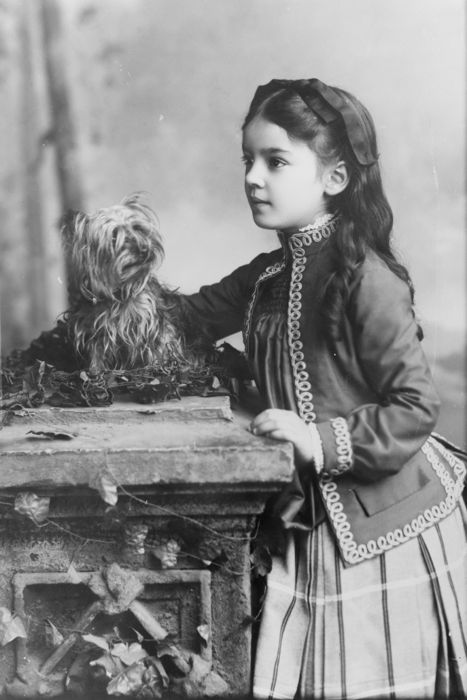 Cute girl with a terrier,1800s