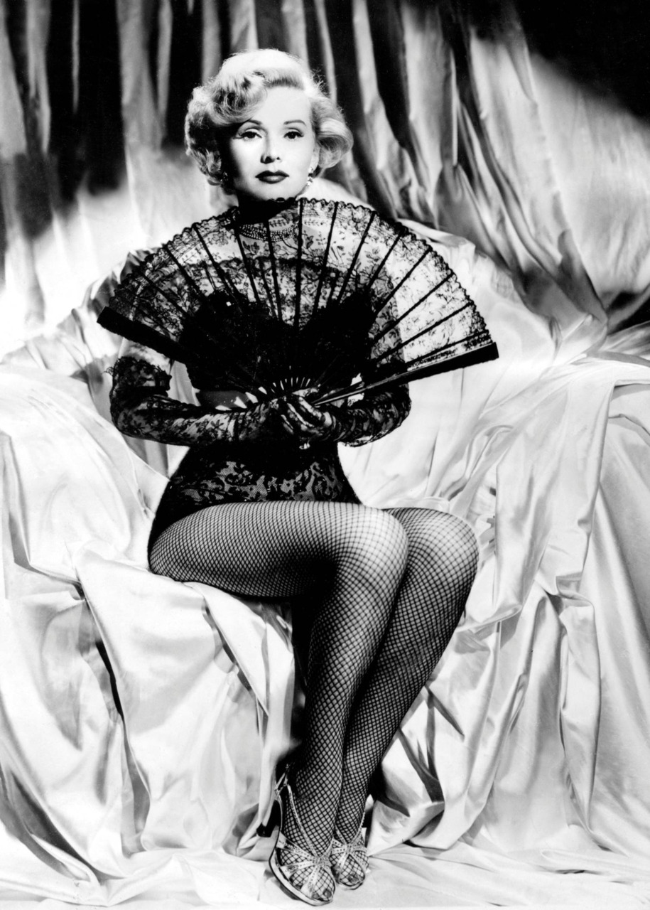 Zsa Zsa Gabor, working some fish net stockings and a lacefan