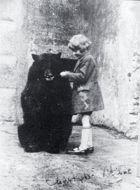 Photograph of the real Pooh bear and Christopher Robin (Milne)