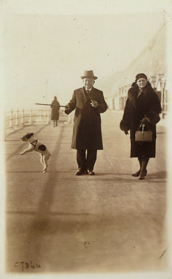 Elderly couple with a terrier