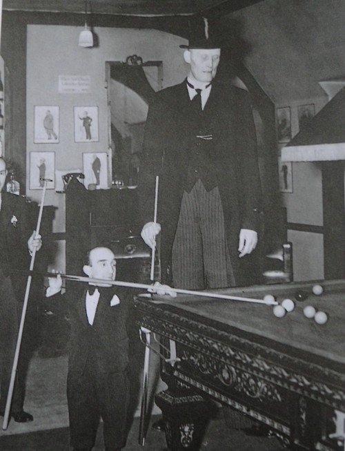 The world's shortest man and the tallest man play a game of pool…