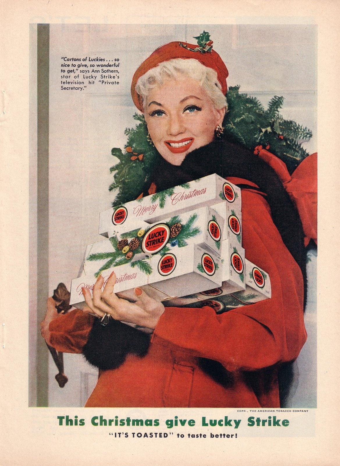 Ann Sothern, giving out cartons of Luckies for Christmas