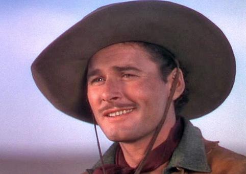 Errol Flynn as acowboy