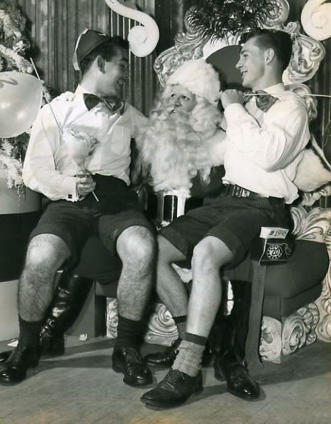 Hey, aren't you boys a little old to be sitting on Santa's lap? And why does Santa have a big smile on his face?