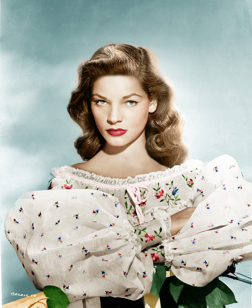 Lauren Bacall, working some humongous sleeves