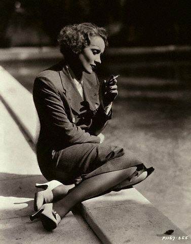 Marlene Dietrich, lost in thought and having a cigarette