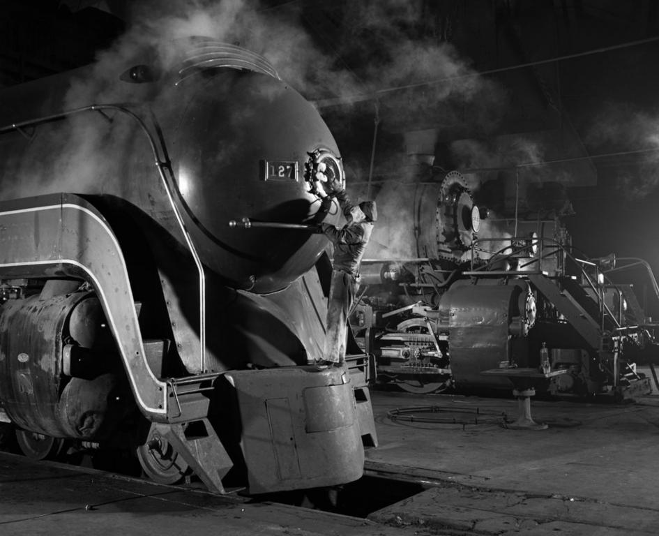 Polishing a train headlight,1930s