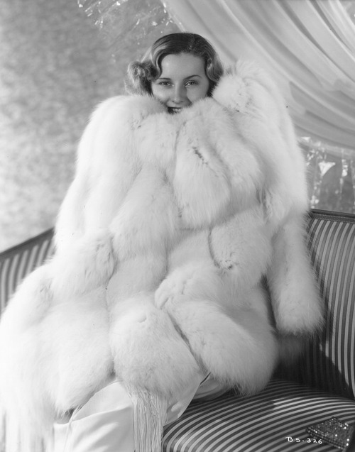 Barbara Stanwyck, swaddled in fur (1930s)