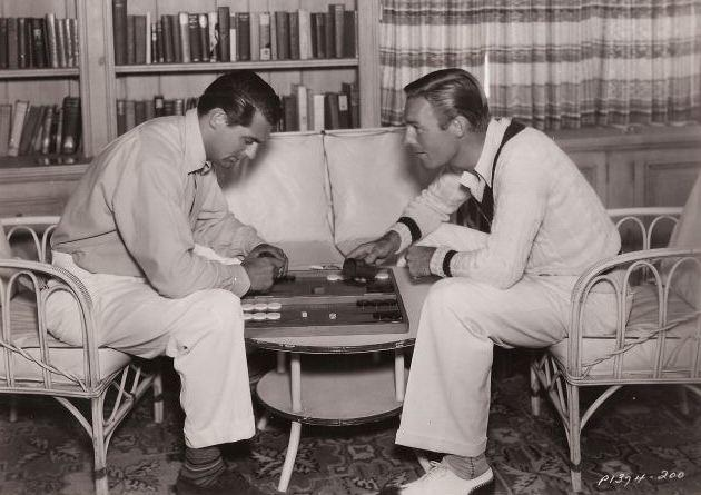 Cary Grant and Randolph Scott playing backgammon, 1930s