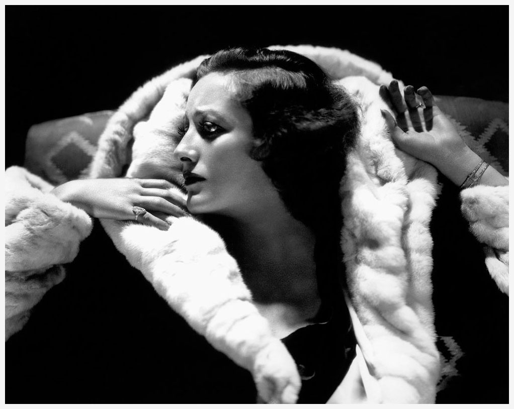 Joan Crawford, working a huge fur collar (1934)