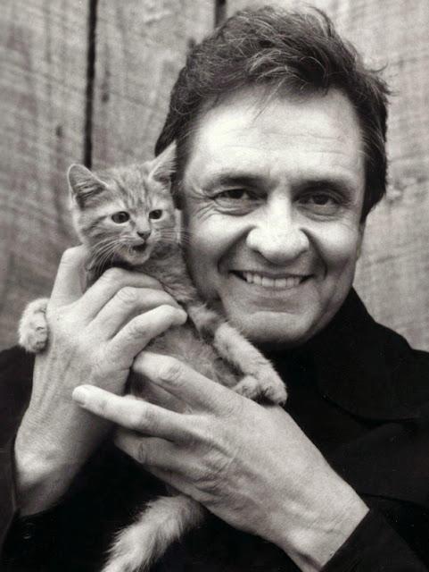 Johnny Cash holding akitten