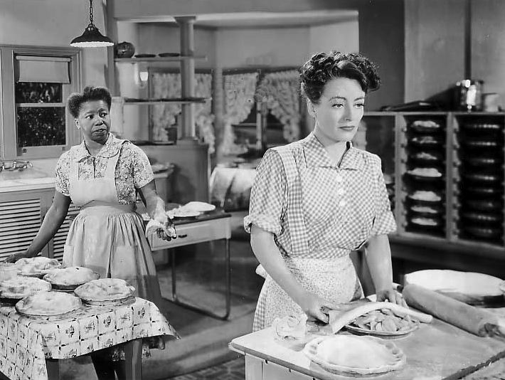 "Joan Crawford in the kitchen, 1942, in ""Mildred Pierce"", cooking up her favourite dish ""Oscar Pie"" (she won an Oscar for this movie)"