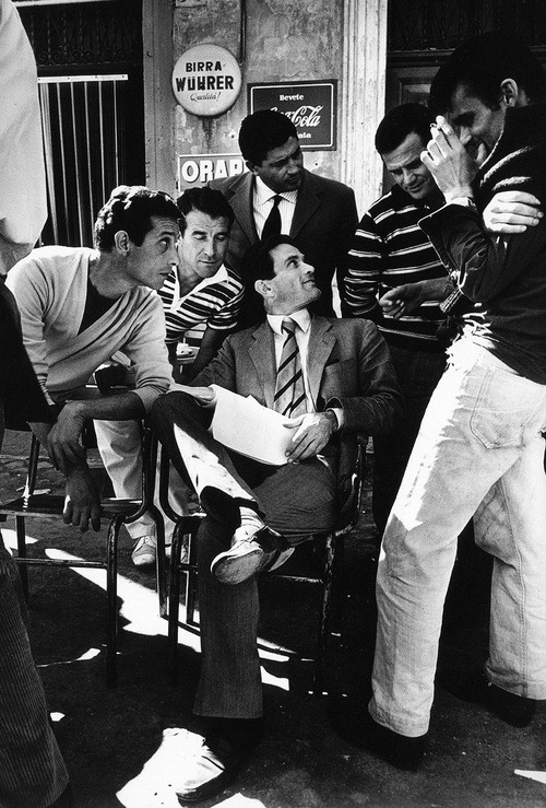 Cary Grant, in Italy, surrounded by guys