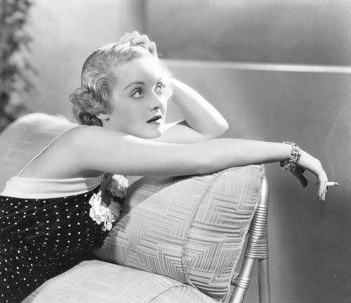 Bette Davis having asmoke