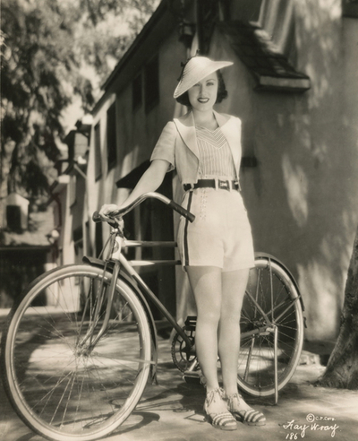 Fay Ray with a bicycle, 1920s(?)