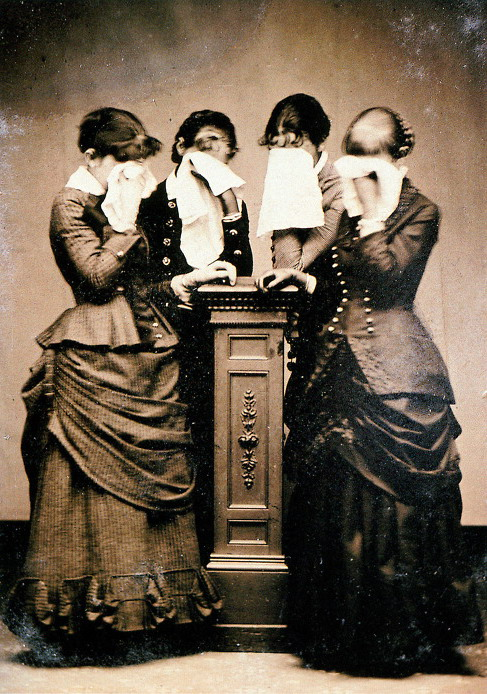 Ladies standing around a mourning post,mourning