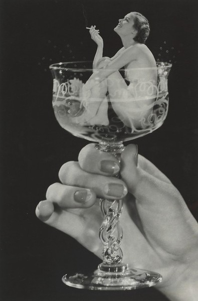 Woman in a champagne glass, smoking abutt