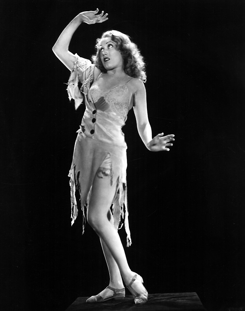 Fay Wray, clothes ripped, as a damsel indistress