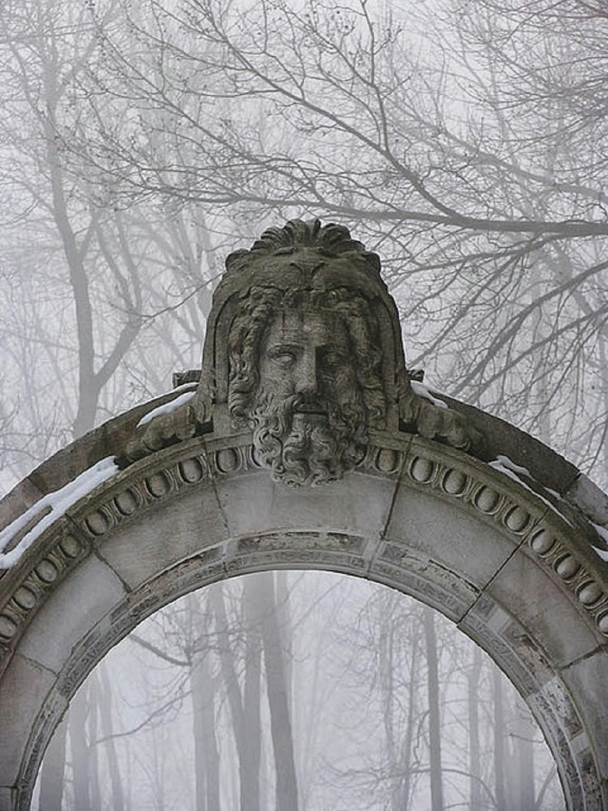 Stone arch in a foggyforest