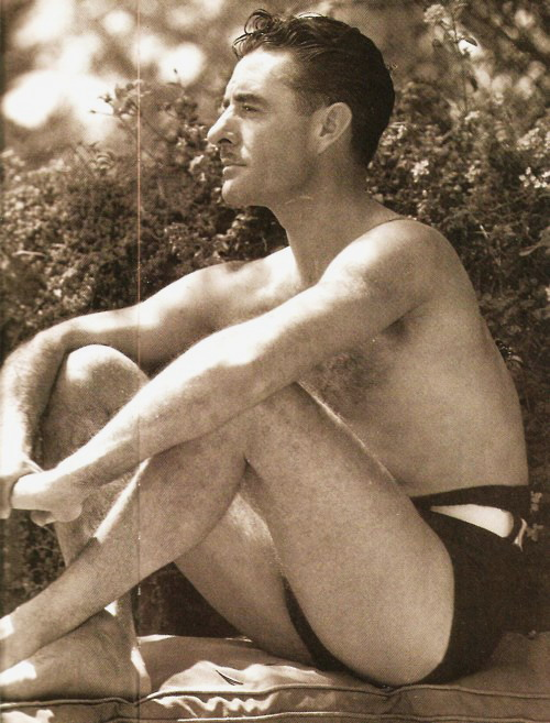 John Gilbert showing some skin