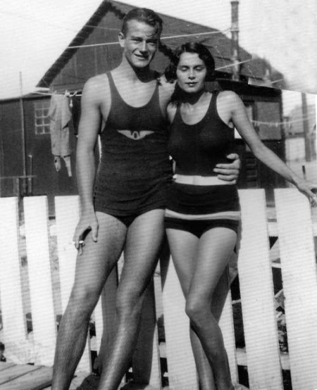 Young John Wayne showing some leg