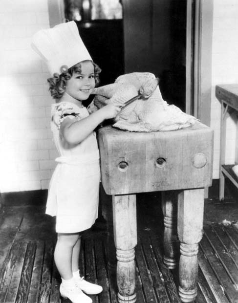 Shirley Temple stuffing a turkey