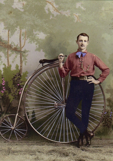 A man and his weird bicycle with a huge front tire