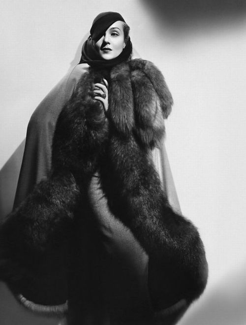 Carole Lombard, swaddled in fur