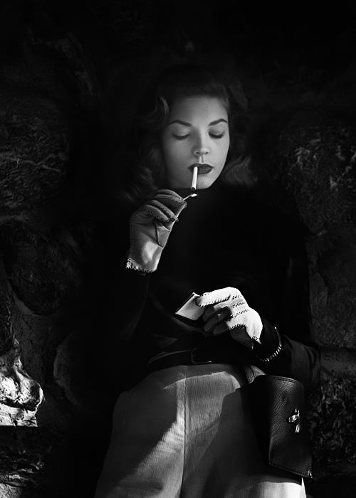 Lauren Bacall, lighting up (photo by John Engstead)