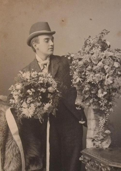 Man with flowers, or is that a woman dressed in men's clothes? I can't tell