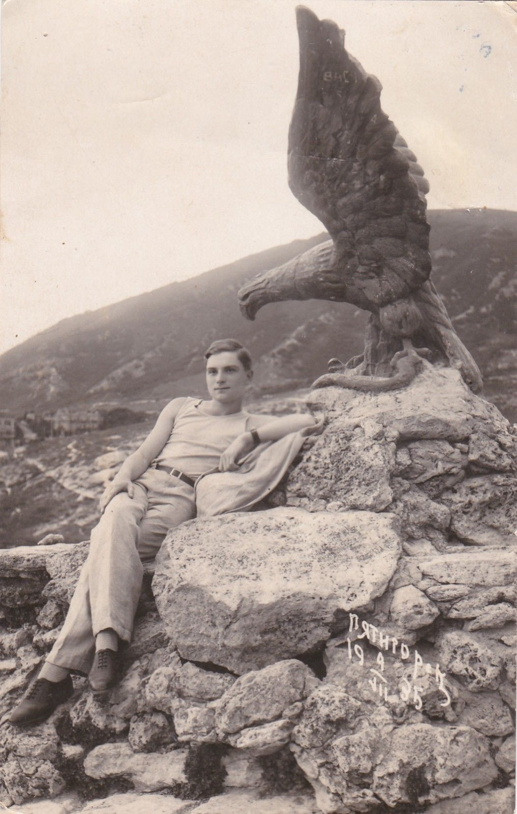 Young man reclining next to an eagle statue, 1935,Russia