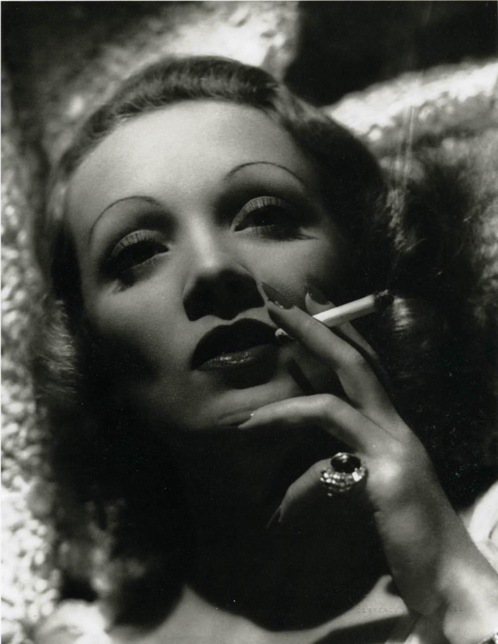 Marlene Dietrich having a puff