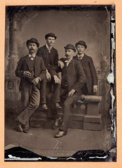 Four mustachioed men, 1800s