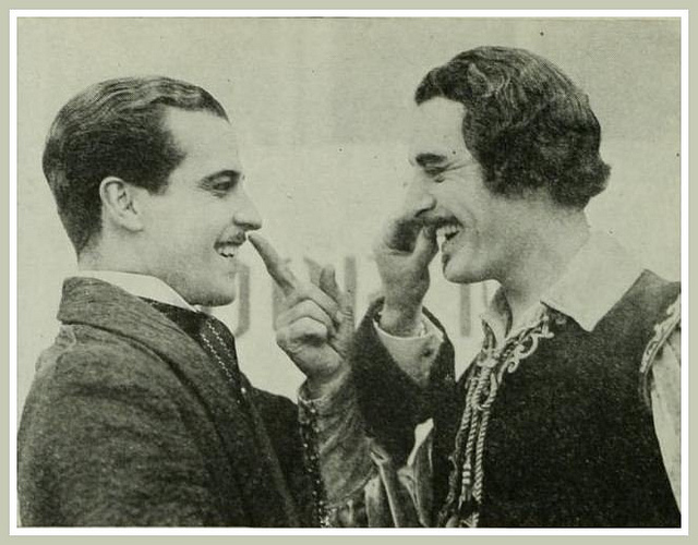Ramon Novarro and John Gilbert, touching each other's moustaches
