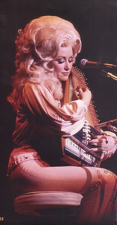 Dolly Parton with an autoharp and BIGhair