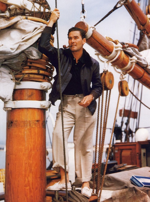 Colour photo of Errol Flynn on a sailing vessel