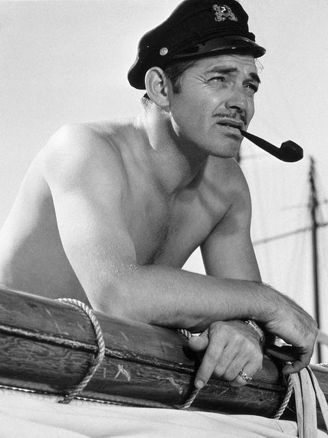 Clark Gable, shirtless and smoking apipe