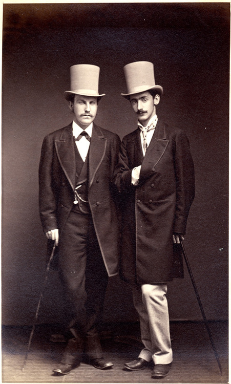 Mustachioed men together, wearing tophats