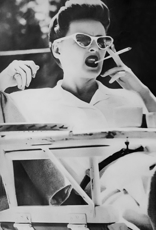 Bette Davis Taking A Smoke Break During The Filming Of