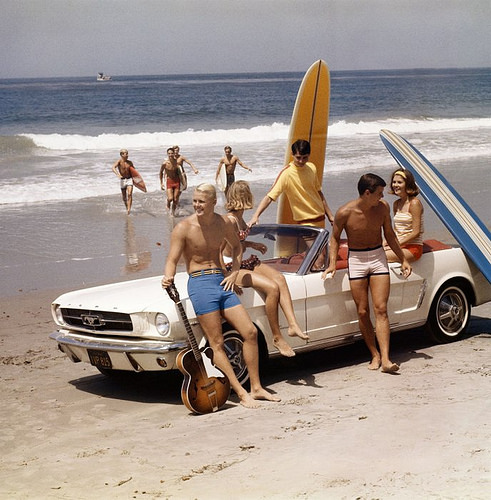 California surfer crowd and a Mustang, 1960s