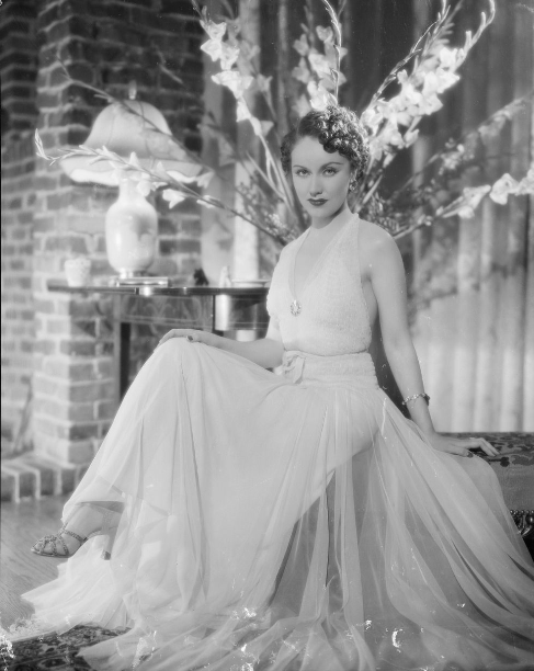 Fay Wray, with a gladioli backdrop