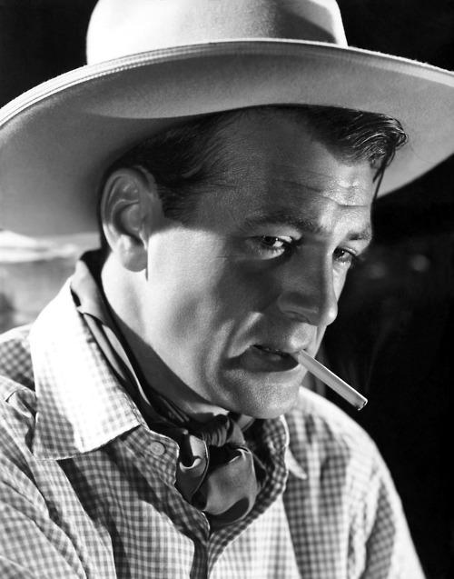 Gary Cooper, cowboy, smoking acigarette