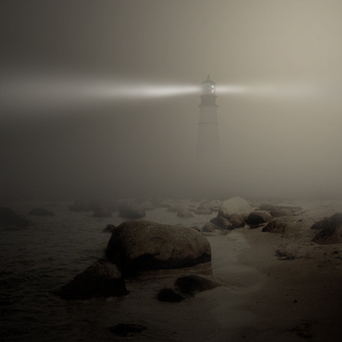 A lighthouse in the fog