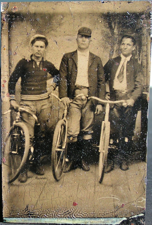 Three men and their bicycles