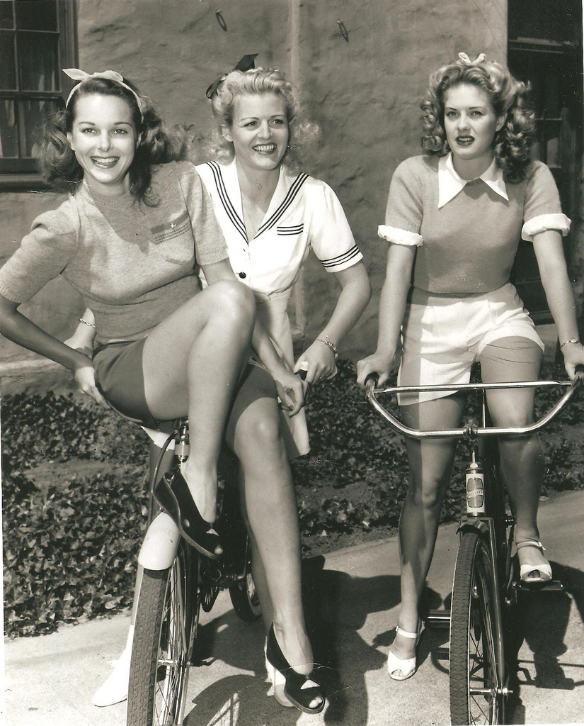 3 Women on bicycles, 1940s