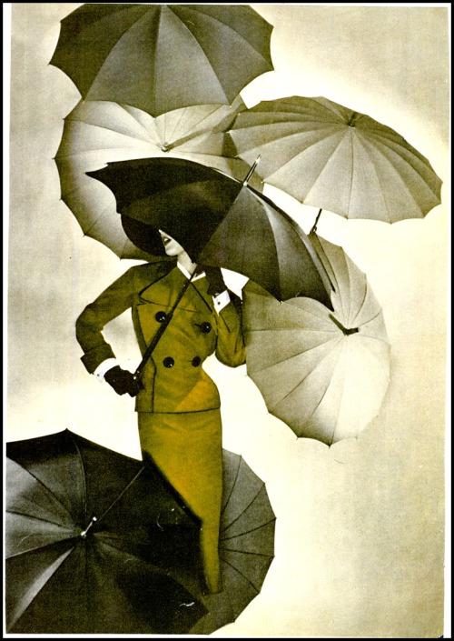 Umbrellas in a fashion illustration, circa1950