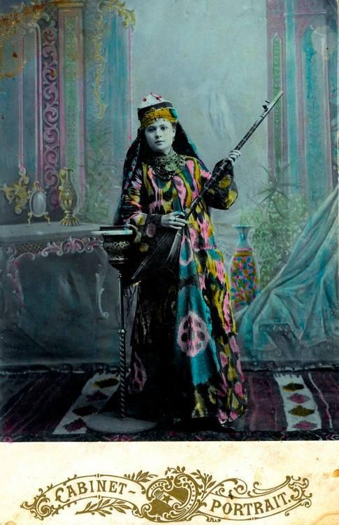 Woman in psychedelic traditional dress,Uzbekistan